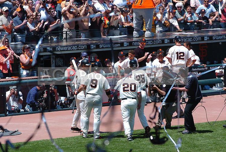 Barry Bonds returns to the dugout after hitting career home run 715 to pass Hank Aaron for second place in the all-time home run lead at At&T Park in San Francisco Sunday May 28, 2006. (Photo by Alan Greth)