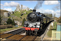 BNPS.co.uk (01202 558833)<br /> Pic: AndrewWright/BNPS<br /> <br /> Steam train on the restored line at Corfe Castle.<br /> <br /> A plucky seaside railway that refused to die is finally rejoing the rail network today after a 45 year fight to reverse the Beeching axe.<br /> <br /> At 10.23 sharp a train will once again leave Swanage in Dorset to rejoin the main network at Wareham, thanks to an army of volunteers who have spent 45 years painstakingly rebuilding their line. 