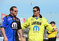 Sept. 30, 2012; Madison, IL, USA: NHRA pro stock driver Allen Johnson (left) and Jeg Coughlin Jr during the Midwest Nationals at Gateway Motorsports Park. Mandatory Credit: Mark J. Rebilas-