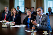 United States President Barack Obama, right, speaks during a cabinet meeting at the White House with Arne Duncan, U.S. education secretary, from left, Sylvia Mathews Burwell, secretary of the U.S. Department of Health and Human Services (HHS), and Sally Jewell, U.S. secretary of the interior secretary, in Washington, D.C., U.S., on Tuesday, July 1, 2014. Obama said yesterday he'll go it alone on changing U.S. immigration rules because House Republicans won't act. <br /> Credit: Andrew Harrer / Pool via CNP