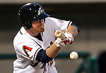 Reno Aces Barry Enright bunts during a triple-A minor league baseball game between the Reno Aces and the Colorado Springs Sky Sox on Thursday, April 5, 2012, in Reno, Nev. The Aces won their season-opener 5-2..Photo by Cathleen Allison