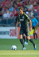 Seattle Sounders FC midfielder Brad Evans #3 in action during an MLS game between the Seattle Sounders FC and the Toronto FC at BMO Field in Toronto on June 18, 2011..The Seattle Sounders FC won 1-0.