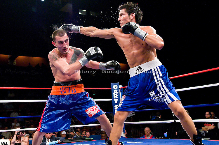 Uncasville, CT - June 7th, 2008: Sergio Martinez (blue/white trunk) on the attack against Archak Termeliksetian during their 8 rounds Super Welterweight fight at the Mohegan Sun Casino. Martinez won by tko in the 7th round. Photo by Thierry Gourjon.