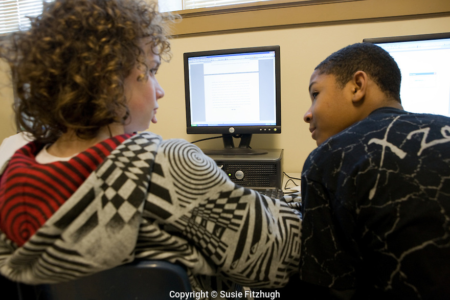 Under the tutelage of one of the Writers in the Schools, seventh-graders at Seattle's TOPS K-8 write their stories on computers.