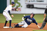 Mississippi Braves outfielder David Rohm (24) slides safely into second as shortstop Jake Hager (2) fields a throw during a game against the Montgomery Biscuits on April 21, 2014 at Riverwalk Stadium in Montgomery, Alabama.  Montgomery defeated Mississippi 6-2.  (Mike Janes/Four Seam Images)