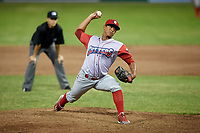 Williamsport Crosscutters relief pitcher Luis Ramirez (15) delivers a pitch in front of umpire Steven Rios during a game against the Batavia Muckdogs on June 21, 2018 at Dwyer Stadium in Batavia, New York.  Batavia defeated Williamsport 6-5.  (Mike Janes/Four Seam Images)