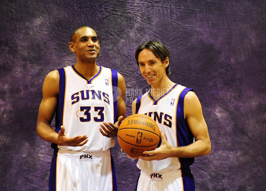 Dec. 16, 2011; Phoenix, AZ, USA; Phoenix Suns guard Steve Nash (right) and forward Grant Hill pose for a portrait during media day at the US Airways Center. Mandatory Credit: Mark J. Rebilas-