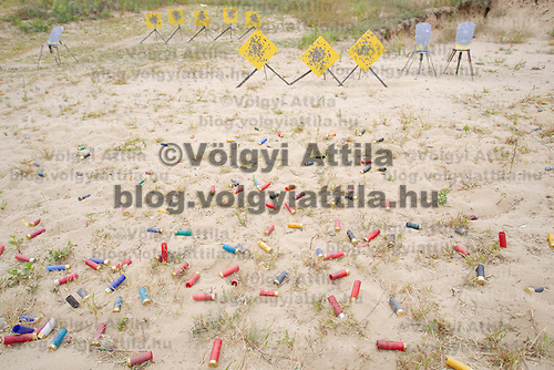 Fired shells lie in the sand around a shooting range after competition during the Cowboy Action Shooting European Championship in Dabas, Hungary on August 11, 2012. ATTILA VOLGYI