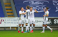 18th July 2020; Liberty Stadium, Swansea, Glamorgan, Wales; English Football League Championship, Swansea City versus Bristol City; Connor Roberts of Swansea City celebrates with teammates after scoring his sides first goal in the 45+2nd minute