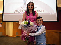 Pictured: Rebecca Storer is presented a bouquet of flowers by Under 9 winner Harrison Pugh. Saturday 27 May 2017<br /> Re: Swansea City FC Academy Awards Evening at the Liberty Stadium, Wales, UK