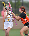 O'Fallon's Kaylie Grout (left) is bumped in the head by the stick of Minooka's Jazzy Holmes. O'Fallon played Minooka in a quarterfinal game of the O'Fallon sectional at O'Fallon Sports Park on Monday May 20, 2019. <br /> Tim Vizer/Special to STLhighschoolsports.com