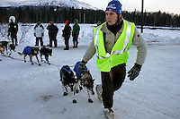 Wednesday March 7, 2007   ----  Kristian Lauvland, a Norwegian high school student guides Louis Nelson Sr.s' dogs to a parking spot where Nelson will take his 24 hour layover at Takotna.  Lauvland is one of 12 Norwegian students taking a month-long outdoor life course in Takotna.