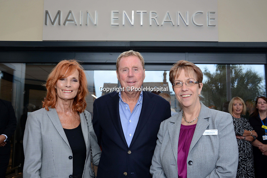BNPS.co.uk (01202 558833)<br /> Pic: PooleHospital/BNPS<br /> <br /> Harry and Sandra with Poole hospital Chief Exec Debbie Fleming.<br /> <br /> I'm A Celebrity winner Harry Redknapp has praised the hospital staff who saved his wife's life a year ago.<br /> <br /> The retired football manager made the comments while unveiling a plaque at the new entrance of Poole Hospital in Dorset.<br /> <br /> His wife Sandra, who also attended the ceremony, fell seriously ill after contracting sepsis last year.<br /> <br /> She was rushed to the hospital in an ambulance where she was able to make a full recovery.