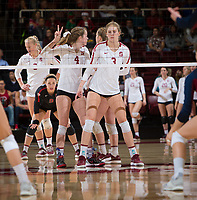 STANFORD, CA - December 1, 2018: Holly Campbell, Meghan McClure, Morgan Hentz, Kathryn Plummer at Maples Pavilion. The Stanford Cardinal defeated Loyola Marymount 25-20, 25-15, 25-17 in the second round of the NCAA tournament.