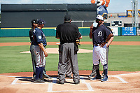 Detroit Tigers third base coach Dave Clark (25) during the lineup exchange with Atlanta Braves bench coach Walt Weiss (4) before a Grapefruit League Spring Training on March 2, 2019 at Publix Field at Joker Marchant Stadium in Lakeland, Florida.  Umpires include Jerry Layne (home plate), Manny Gonzalez (left), Hunter Wendelstedt (hidden), and James Hoye (behind Clark).  Tigers defeated the Braves 7-4.  (Mike Janes/Four Seam Images)