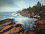 Waves crash into the granite coastline along Ocean Drive near Newport Cove in Acadia National Park, Maine, USA
