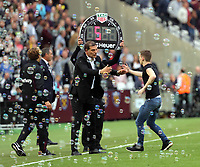 A pitch invader is helped off the pitch by West Ham manager Slaven Bilic during the Premier League match between West Ham United v Swansea City at the London Stadium, London, England, UK. Saturday 30 September 2017