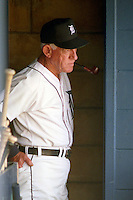 Detroit Tigers manager Sparky Anderson in the dugout smoking a pipe during Spring Training 1993 at Joker Marchant Stadium in Lakeland, Florida.  (MJA/Four Seam Images)