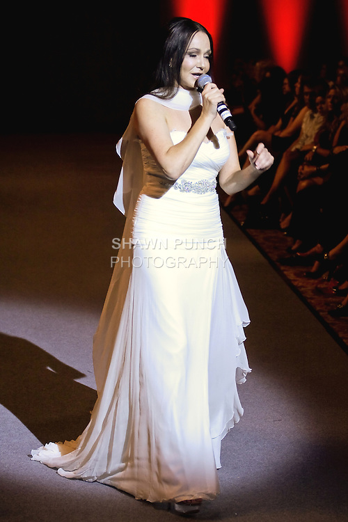 Singer Angeles Dominiguez performs on the runway during Couture Fashion Week at the Waldorf Astoria Hotel in New York City, on September 15, 2012.
