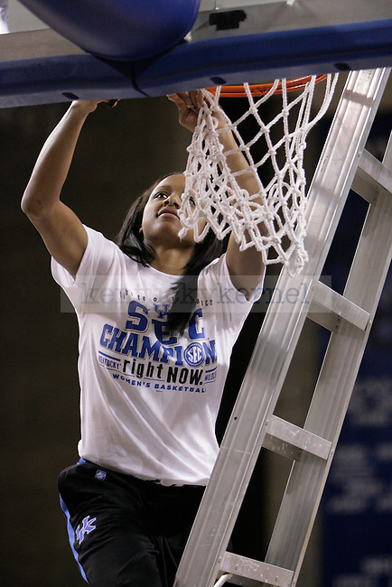 Sophomore Maegan Conwright  cuts down a piece of the net during the Kentucky Women's celebration of winning the SEC regular season championship 2/26/12 at Memorial Coliseum in Lexington, Ky. Photo by Quianna Lige | Staff