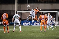 HEMPSTEAD, NY – OCTOBER 12: Marcos Senna of the New York Cosmos battles for an aerial ball against the Carolina RailHawks during an NASL match on October 12, 2013 at  Shuart Stadium in Hempstead, New York.