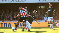 Bryan Mbeumo of Brentford shakes off a challenge from Middlesbrough's Lewis Wing during Brentford vs Middlesbrough, Sky Bet EFL Championship Football at Griffin Park on 8th February 2020