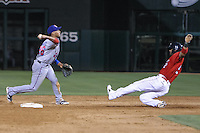 Yangervis Solarte (26) of the Round Rock Express throws to first base over Jonathan Villar (2) of the Oklahoma City RedHawks during the Pacific Coast League game at Chickashaw Bricktown Ballpark on June 14, 2013 in Oklahoma City ,Oklahoma.  (William Purnell/Four Seam Images)