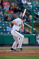 Rochester Red Wings right fielder Nick Buss (12) follows through on a swing during a game against the Pawtucket Red Sox on May 19, 2018 at Frontier Field in Rochester, New York.  Rochester defeated Pawtucket 2-1.  (Mike Janes/Four Seam Images)