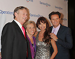 BEVERLY HILLS, CA - SEPTEMBER 28: Dr. Bill Magee, Kathy Magee, Roma Downey and Mark Burnett attend Operation Smile's 30th Anniversary Smile Gala - Arrivals at The Beverly Hilton Hotel on September 28, 2012 in Beverly Hills, California.