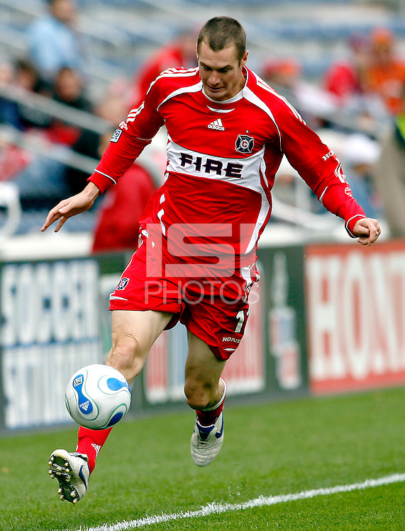 Chicago Fire midfielder Nate Jaqua (11) controls the ball.  The Chicago Fire defeated the New England Revolution 1-0 in the first game of their playoff series at Toyota Park in Bridgeview, IL on October 22, 2006..