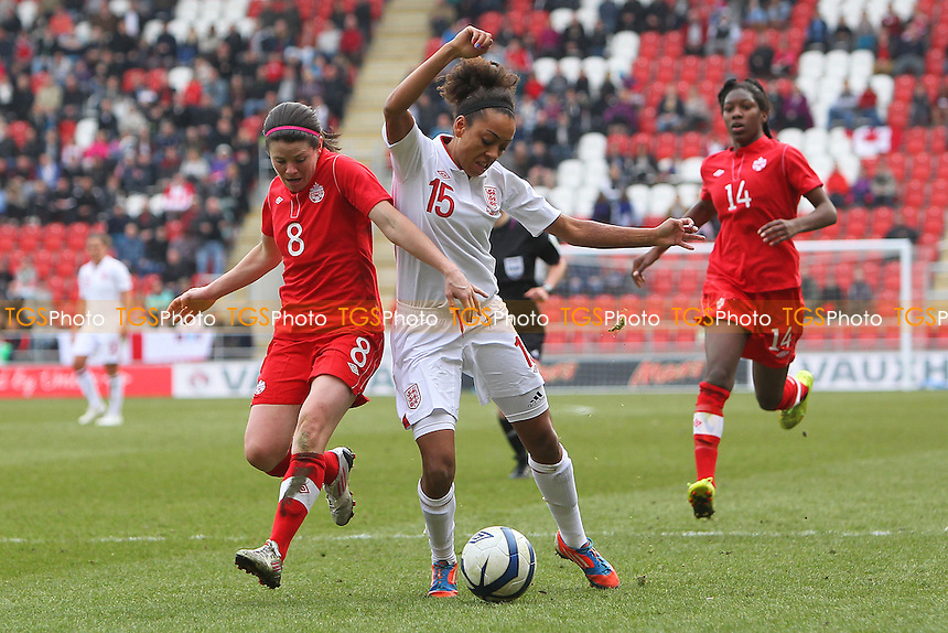 Jess Clarke of England tangles with Diana Matheson of Canada inside the box - England Women vs Canada Women - International Football Friendly Match at the New York Stadium, Rotherham United FC - 07/04/13 - MANDATORY CREDIT: Gavin Ellis/TGSPHOTO - Self billing applies where appropriate - 0845 094 6026 - contact@tgsphoto.co.uk - NO UNPAID USE.