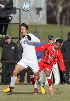 Amherst forward Nico Pascual-Leone (8) attempts to control the ball as St. Lawrence forward Praveen Balakumaran (23) pressures. NCAA Division III Sectionals. In double-overtime, Amherst College (white) defeated St. Lawrence University (red), 2-1, on Hitchcock Field at Amherst College on November 23, 2013.