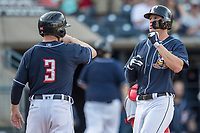 Toledo Mud Hens outfielder JaCoby Jones (21) is greeted at the plate by teammate Alex Presley (3) after his first inning home run against the Louisville Bats during the International League baseball game on May 17, 2017 at Fifth Third Field in Toledo, Ohio. Toledo defeated Louisville 16-2. (Andrew Woolley/Four Seam Images)