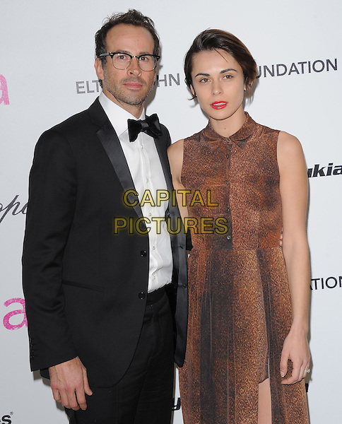 JASON LEE & CEREN ALKAC.19th Annual Elton John AIDS Foundation Academy Awards Viewing Party held at The Pacific Design Center, West Hollywood, California, USA..February 27th, 2011.half length tuxedo brown sleeveless dress married husband wife black white glasses .CAP/RKE/DVS.©DVS/RockinExposures/Capital Pictures.