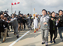 Suzy (miss A), Nov 1, 2017 : South Korean actress and singer from girl group miss A, Suzy (C), who is a torch bearer, attends the Olympic Torch Relay on the Incheon Bridge in Incheon, west of Seoul, South Korea. The Olympic flame arrived in Incheon, South Korea on Wednesday and it is going to be passed across the country during a 100-day tour until the opening ceremony of the 2018 PyeongChang Winter Olympics which will be held for 17 days from February 9 - 25, 2018. (Photo by Lee Jae-Won/AFLO) (SOUTH KOREA)