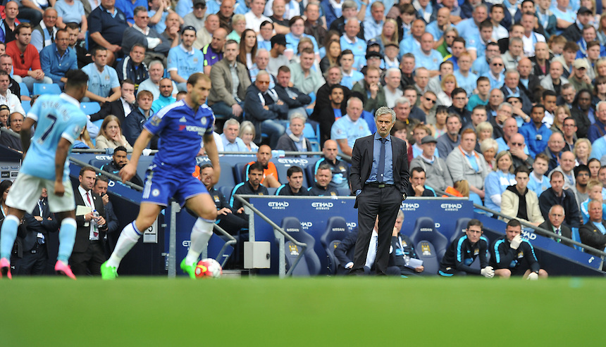 Chelsea manager Jose Mourinho looks a dejected figure as he watches his team trail 1-0 at half time<br /> <br /> Photographer Dave Howarth/CameraSport<br /> <br /> Football - Barclays Premiership - Manchester City v Chelsea - Sunday 16th August 2015 - Etihad Stadium - Manchester<br /> <br /> &copy; CameraSport - 43 Linden Ave. Countesthorpe. Leicester. England. LE8 5PG - Tel: +44 (0) 116 277 4147 - admin@camerasport.com - www.camerasport.com