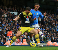 2nd November 2019; Etihad Stadium, Manchester, Lancashire, England; English Premier League Football, Manchester City versus Southampton; Cedric Soares of Southampton holds off Bernardo Silva of Manchester City - Strictly Editorial Use Only. No use with unauthorized audio, video, data, fixture lists, club/league logos or 'live' services. Online in-match use limited to 120 images, no video emulation. No use in betting, games or single club/league/player publications