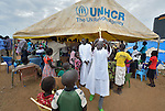 The cross bearer processes out of a tent following a Roman Catholic Mass on Easter morning, April 5, inside a United Nations base in Juba, South Sudan, where some 34,000 people have sought protection since violence broke out in December 2013. More than 112,000 people currently live on UN bases in the war-torn country, most of them afraid of tribally targeted violence. The Catholic Church has maintained a pastoral presence inside the camps.