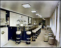 BNPS.co.uk (01202 558833)<br /> Pic:    CanterburyAuctionGalleries/BNPS<br /> <br /> A private bar on board the ship.<br /> <br /> Remarkable photos of the iconic ocean liner SS Normandie which was like a 'floating palace' have come to light over 80 years later.<br /> <br /> The giant 1,000ft long French passenger ship was the largest of her type in the world and won the coveted 'Blue Riband' for the fastest crossing of the Atlantic.<br /> <br /> English photographer Percy Byron's photos show the liner's luxurious 'Art Deco' interior with its chandeliers and pillars of Lalique glass.<br /> <br /> The vessel, which launched in 1935, even boasted its own swimming pool and a gym where young women can be seen doing aerobics while a man in a suit trains with a punch bag.