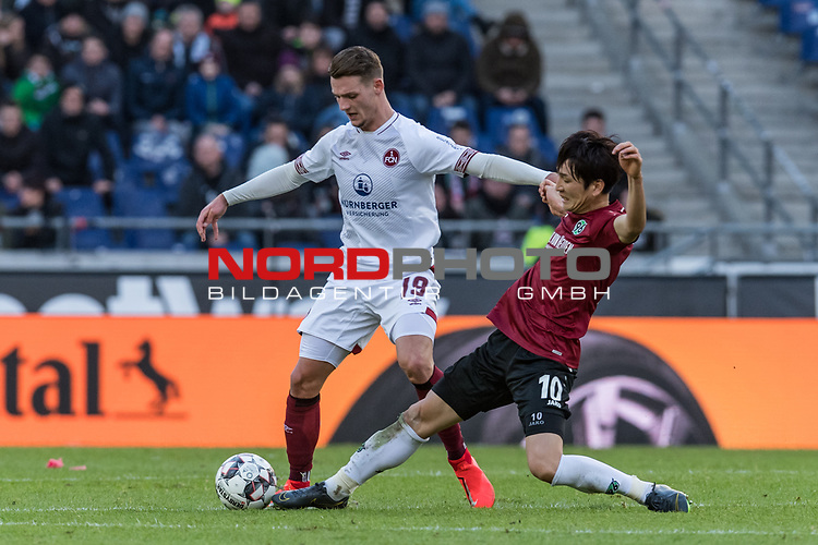09.02.2019, HDI Arena, Hannover, GER, 1.FBL, Hannover 96 vs 1. FC Nuernberg<br /> <br /> DFL REGULATIONS PROHIBIT ANY USE OF PHOTOGRAPHS AS IMAGE SEQUENCES AND/OR QUASI-VIDEO.<br /> <br /> im Bild / picture shows<br /> Törles Knöll / Toerles Knoell (Nuernberg #19)im Duell / im Zweikampf mit Genki Haraguchi (Hannover 96 #10), <br /> <br /> Foto © nordphoto / Ewert