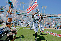 Sept 11, 2011:   Jacksonville Jaguars defensive back William Middleton (29) carries the American flag while leading the team on the field during action between the Jacksonville Jaguars and the Tennessee Titans at EverBank Field in Jacksonville, Florida.   ........