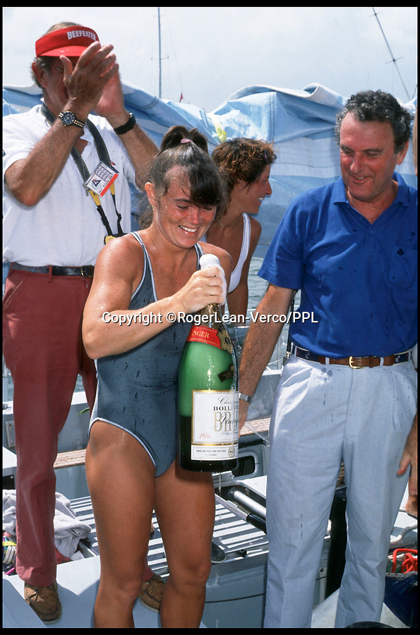 "BNPS.co.uk (01202 558833)<br /> Pic: RogerLean-Verco/PPL/BNPS<br /> <br /> ***Please use full byline*** <br /> <br /> 1985/6 Whitbread Round the World Yacht Race: Tracy Edwards, skipper of 'Maiden' accepts the victor's champagne  on arrive at Fort Lauderdale.<br /> <br /> A boat that sailed into the history books 27 years ago but subsequently ran to ruin has been rescued by its former skipper and is now due to arrive home. <br /> <br /> Sailing heroine Tracy Edwards hit headlines in 1990 after leading the first all-female crew to the finish line of the prestigious Whitbread Round the World Race.<br /> <br /> When Miss Edwards, 54, checked up on the boat, called Maiden, in 2014 she was ""shocked"" and ""saddened"" to find it in a state of complete disrepair. <br /> <br /> After a successful fundraising campaign Maiden is scheduled to take to the seas once again June 2018 after being returned to her to her former glory."