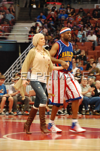 JAIME PRESSLY, HOT SHOT BRANCH. Celebrities attend a basketball game featuring the Harlem Globetrotters at the Honda Center, Anaheim, CA, USA. February 13, 2010.