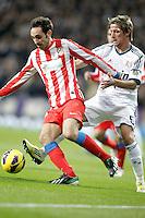 Real Madrid's Fabio Coentrao against Atletico de Madrid's Juanfran Torres during La Liga Match. December 01, 2012. (ALTERPHOTOS/Alvaro Hernandez)