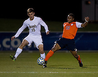 Evan Panken (15) of Notre Dame is tackled by Kyler Sullivan (13) of Virginia during the ACC tournament semifinals at the Maryland SoccerPlex in Boyds, MD.  Virginia advanced to the finals after tying Notre Dame, 3-3, in overtime and then defeating them on penalty kicks.