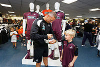 Pictured: Lee Trundle with young fan. Friday 24 August 2018<br /> Re: Swansea City FC third kit launch at the club shop, Liberty Stadium, Swansea, Wales, UK.