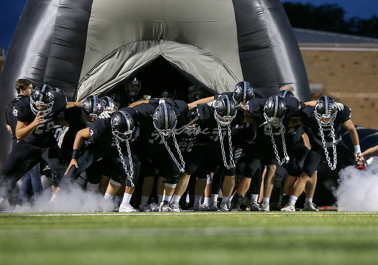 The Vandegrift Vipers take the field for a high school football game between the Vandegrift Vipers and the Leander Lions at Monroe Stadium in Austin, Texas, on October 7, 2016.