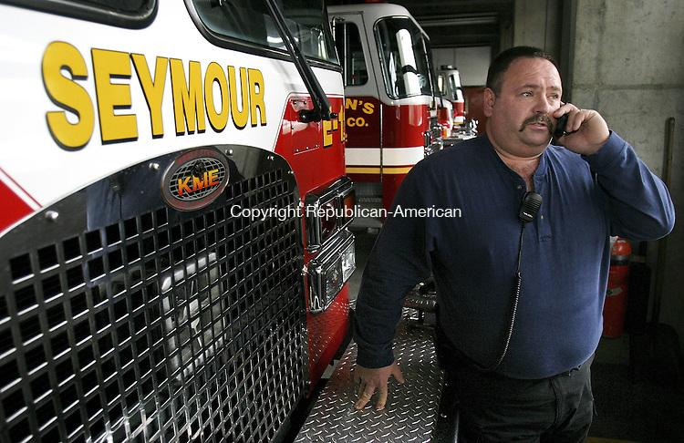 SEYMOUR, CT. 03 February 2009-020309SV02--Scott Andrews, fire chief of The Citizen's Engine Company takes a call in the truck house while on duty at the firehouse in Seymour Tuesday. Citizen's is celebrating its 125th Anniversary this year. <br /> Steven Valenti Republican-American