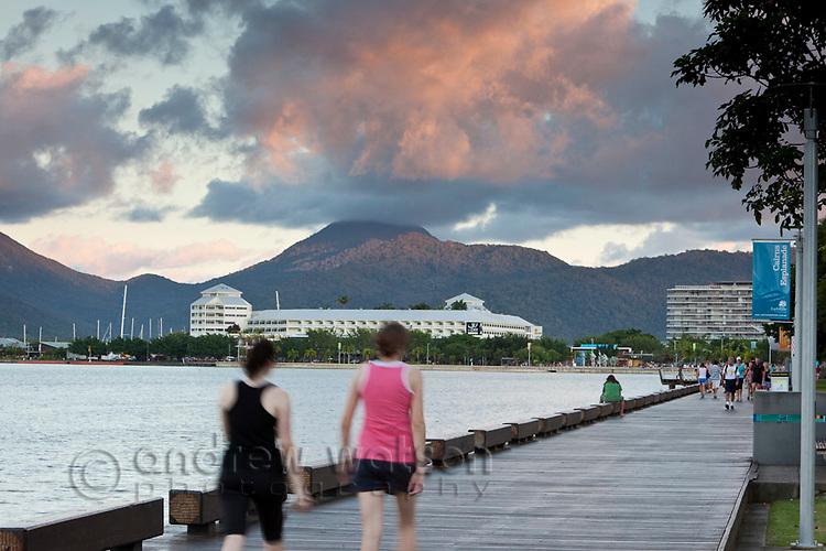 Walkers on the Esplanade boardwalk.  Cairns, Queensland, Australia