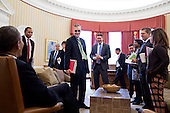 United States President Barack Obama talks with senior advisors following a meeting in the Oval Office, February 27, 2013. Standing, from left, are: Rob Nabors, Deputy White House Chief of Staff for Policy; Pete Rouse, Counselor to the President; Senior Advisor Valerie Jarrett; Chief of Staff Denis McDonough; Senior Advisor Dan Pfeiffer; Mark Childress, Deputy Chief of Staff for Planning; Miguel Rodriguez, Director of Legislative Affairs; Danielle Gray, Cabinet Secretary; Press Secretary Jay Carney; and Alyssa Mastromonaco, Deputy Chief of Staff for Operations. .Mandatory Credit: Pete Souza - White House via CNP